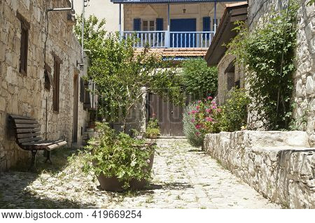 Cobbled Street With Old Stone Houses In Traditional Cypriot Village