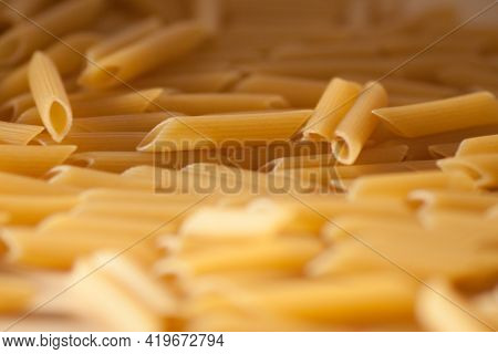 Penne Pasta Background. Pasta Penne Texture Background.
