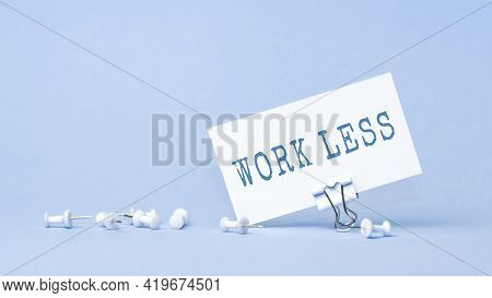 Work Less - Concept Of Text On Business Card. Closeup Of A Personal Agenda On Blue Background