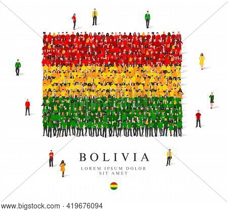 A Large Group Of People Are Standing In Green, Yellow And Red Robes, Symbolizing The Flag Of Bolivia