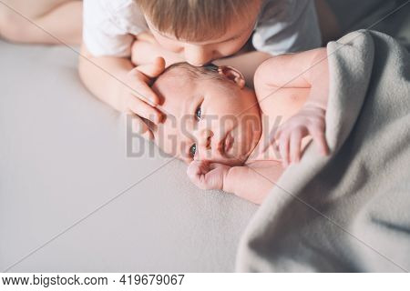Siblings Bonding. A Boy And His Little New Born Brother. Preschool сhild And Newborn Baby One Week O
