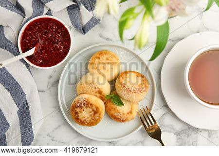 Delicious Cottage Cheese Pancakes With Mint And Icing Sugar On White Marble Table, Flat Lay