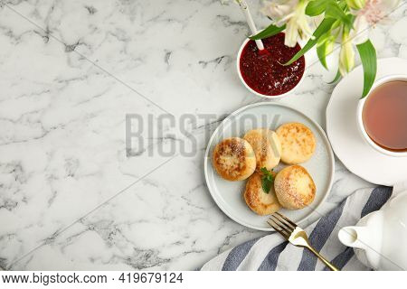 Delicious Cottage Cheese Pancakes With Icing Sugar On White Marble Table, Flat Lay. Space For Text
