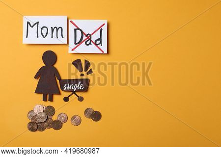Being Single Mother Concept. Woman With Pram Made Of Paper, Coins And Space For Text On Orange Backg