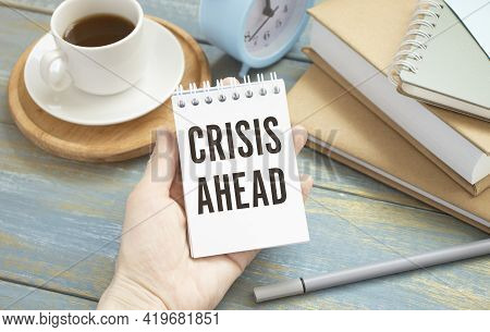 Business Woman Holding A Card With Text Crisis Ahead