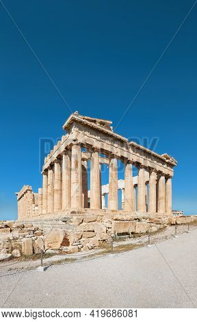 Parthenon Temple On A Bright Day With Blue Sky And Clouds. Panoramic Image Of Ancient Buildings In A