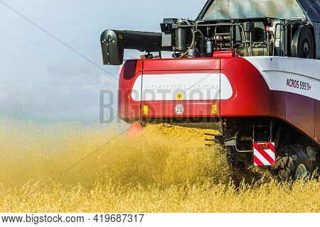 Belgorod Region, Russia - July 18, 2019: Rostselmash Acros 595 Combine Harvester At Work. Back View