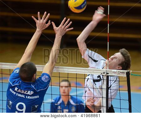 KAPOSVAR, HUNGARY - FEBRUARY 1: Bence Bozoki (R) in action at a Middle European League volleyball game Kaposvar HUN (w) vs Innsbruck AUT (b), February 1, 2013 in Kaposvar, Hungary