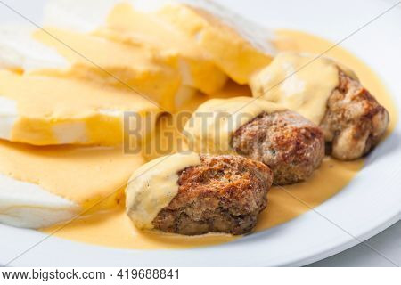 minced meat ball with creamy sauce and dumplings