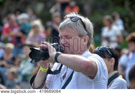 Photographers And Spectators With Cameras At The Festival