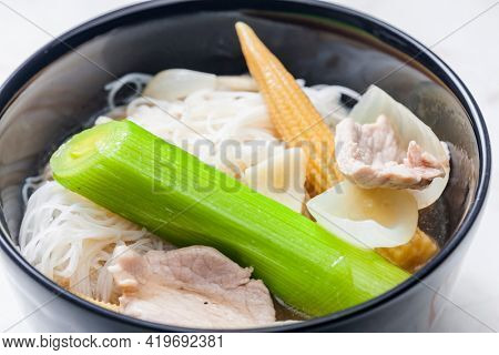 soup pho with vegetables and rice noodles