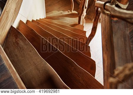 Old Wooden Staircase With Railings In The House, Descent From The Second Floor