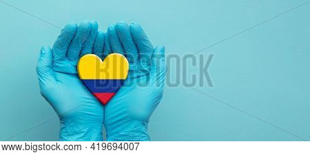 Doctors Hands Wearing Surgical Gloves Holding Colombia Flag Heart
