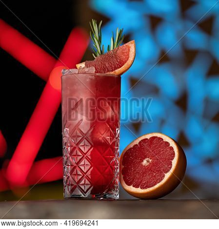 Refreshing Cocktail With Ice, Rosemary And Grapefruit Or Red Sicilian Orange. Glass With Alcoholic O