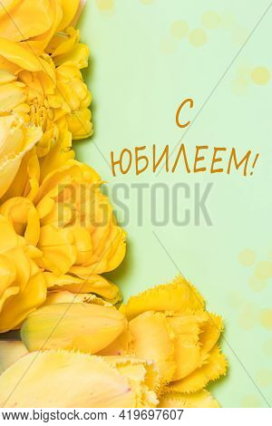 Vertical Photo With Yellow Tulip Flowers On A Green Background With The Inscription In Russian Happy