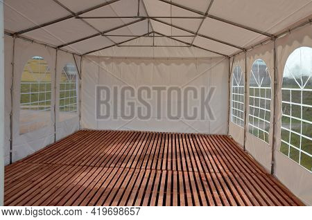 A Large Plastic Tent Used As A Temporary Shelter For Entertaining Guests At Weddings And Concerts An