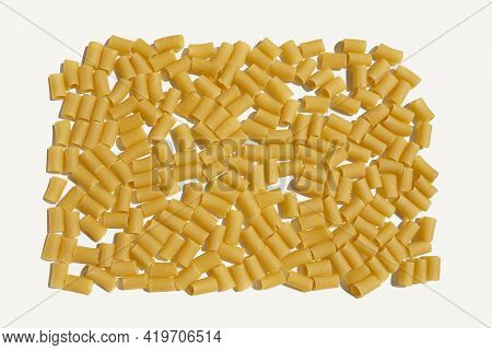White Kitchen Table With Large Group Of Rigatoni Pasta Noodles Arrangement Background