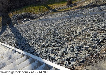 The Drainage Chute To The Sewer And The Slope Is Reinforced From Washouts With Gabions. A Grid Fille
