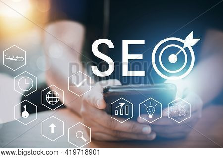 Seo Search Engine Optimization Concept With Phone, Businessman Working To High Ranking Traffic On We