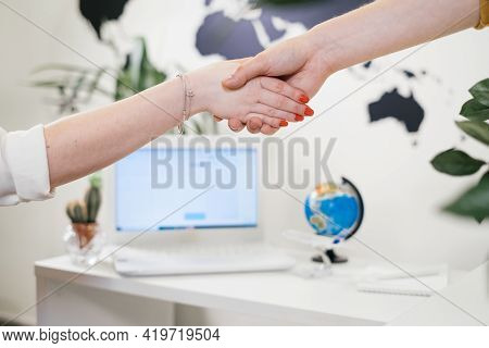 Buy Tour In Travel Agency, Communication With A Travel Agent Travelling Concept, Shaking Hands, Clos