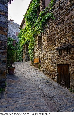 Narrow Alley Of Old Town With Facades Of Stone And Ivy. Patones De Arriba Madrid. Spain.