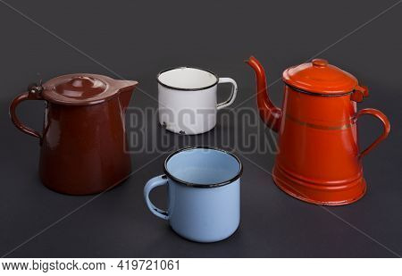 An Old Vintage Enamel Teapot And Cup