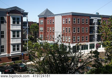NORWALK, CONNECTICUT - MAY 6, 2021: Apartment complex Head Of The Harbor South  view from Mill Hill historic park