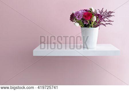 Seasonal Flowers In A Vase On A Floating Shelf