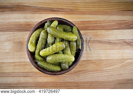 A Cup Of Pickled Cucumbers On A Wooden Background. Salted Cucumbers.