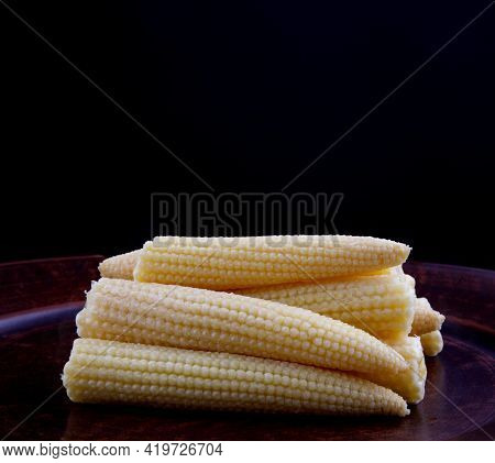 Cobs Of Juicy Young Corn. Pickled Corn. Delicious Baby Corn.