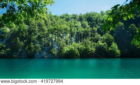 Reflection Of A Overgrown Rock Wall In A Lake Of Plitvice Lakes National Park.