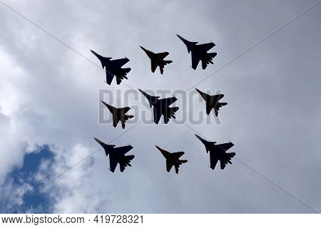 Moscow, Russia - May 7, 2021: Airplane Silhouettes Of Aerobatic Groups Russian Knights And Swifts On