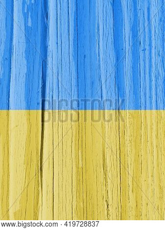 Flag Of Ukraine On Dry Wooden Surface, Cracked With Age. Vertical Background Or Mobile Phone Wallpap