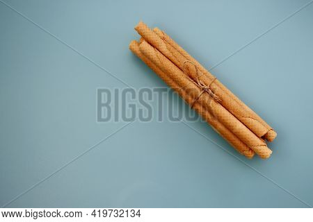 A Bunch Of Wafer Rolls On A Gray-blue Background. Long Wafer Rolls
