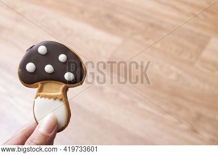 Hand Holds Mushroom Shaped Cookies Close Up, Copy Space