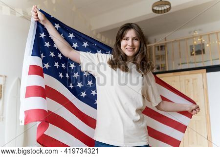 A Resident Of America Celebrates A National Holiday. The American Flag. Democracy, Freedom, Independ