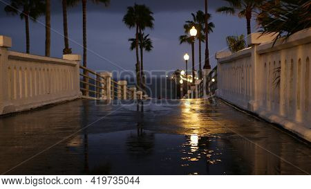 Rain Drops, Evening Dark Sky With Clouds, Oceanside California Usa. Empty Pier, Puddle, Palms In Twi