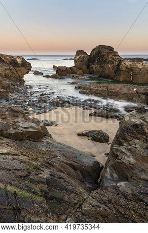Beautiful And Unusual Landscape Image Of Landmark Godrevy Lighthouse On Cornwall's Coastline