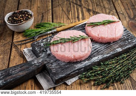 Raw Burgers Patty From Organic Chicken And Turkey Meat With Thyme And Rosemary. Wooden Background. T