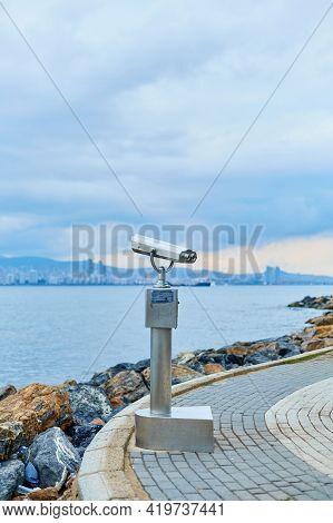 Tourist Sightseeing Binoculars On The Promenade Of Buyukada Island Overlooking Istanbul.