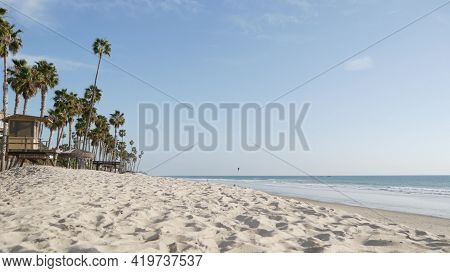 Tropical Palm Trees, White Sandy Beach By Sea Water Wave, Pacific Ocean Coast, San Clemente Californ