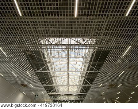 Roof Metal Trusses In The Shopping Center. Lamps And Light, Perspective