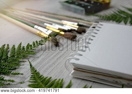 Drawing Supplies Are On Desktop At Home. Freelancer, Home Training. Art Supplies, Brushes, Albums, N