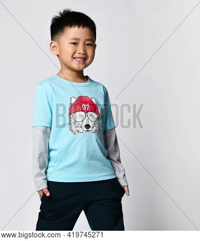 Preschool Little Smiling Asian Boy In Trendy Trendy Raglan With Cool Wolf Print And Sweatpants Stand