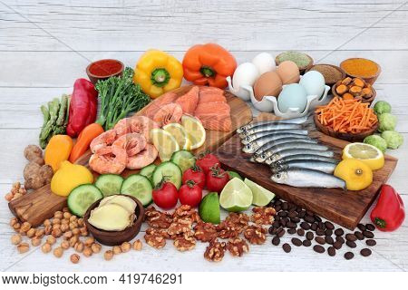 Healthy food for a low cholesterol diet with foods high in protein, omega 3, vitamins, minerals, antioxidants, anthocyanins, lycopene and  fibre. Immune boosting healthcare concept.