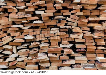 Stack Of Wooden Planks Close-up. Close Up Of Wooden Boards. Texture Of Industrial Natural Timber Bui