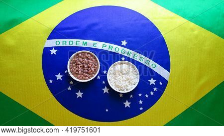 Typical Brazilian Food Dish With Brazilian Flag In The Background.