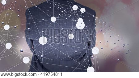 Network of connections with a businessman's back in the background, networking concept. digitally generated image.