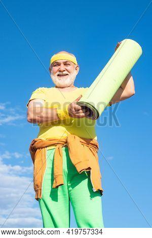 Senior Sport Man Is Doing Sport Outdoors. Active Leisure. Sport And Retirement Concept. Elderly Man