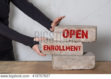 Open Enrollment Concept. Stack Of White Bricks On A Wooden Table